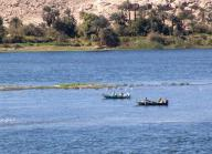 nile;-river;-nile-river;-shoreline;-boats;-fishing