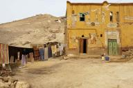 egypt;-village;-town;-house;-home;-mud-house;-mud-home;-mud-brick;-laundry;-dirt-road;-poor;-life