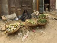egypt;-luxor;-city-of-luxor;-street;-alley;-back-alley;-street-scene;-people;-woman;-local;-poor;-life;-food;-vendor;-street-vendor
