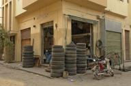 egypt;-luxor;-city-of-luxor;-back-alley;-alley;-shop;-vendor;-tire-shop;-tires;-motorcycle;-business