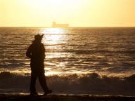 waves;sunset;silhoutte;sand;San;Fransisco;Bay;Pacific;Ocean;ocean;Baker;Beach;people;walking;leisure